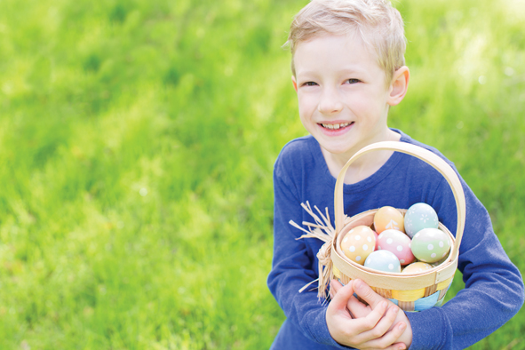 A young boy smiles at his Easter egg collection - Look after your teeth this Easter with a little help from Manor Dental Health in Hull