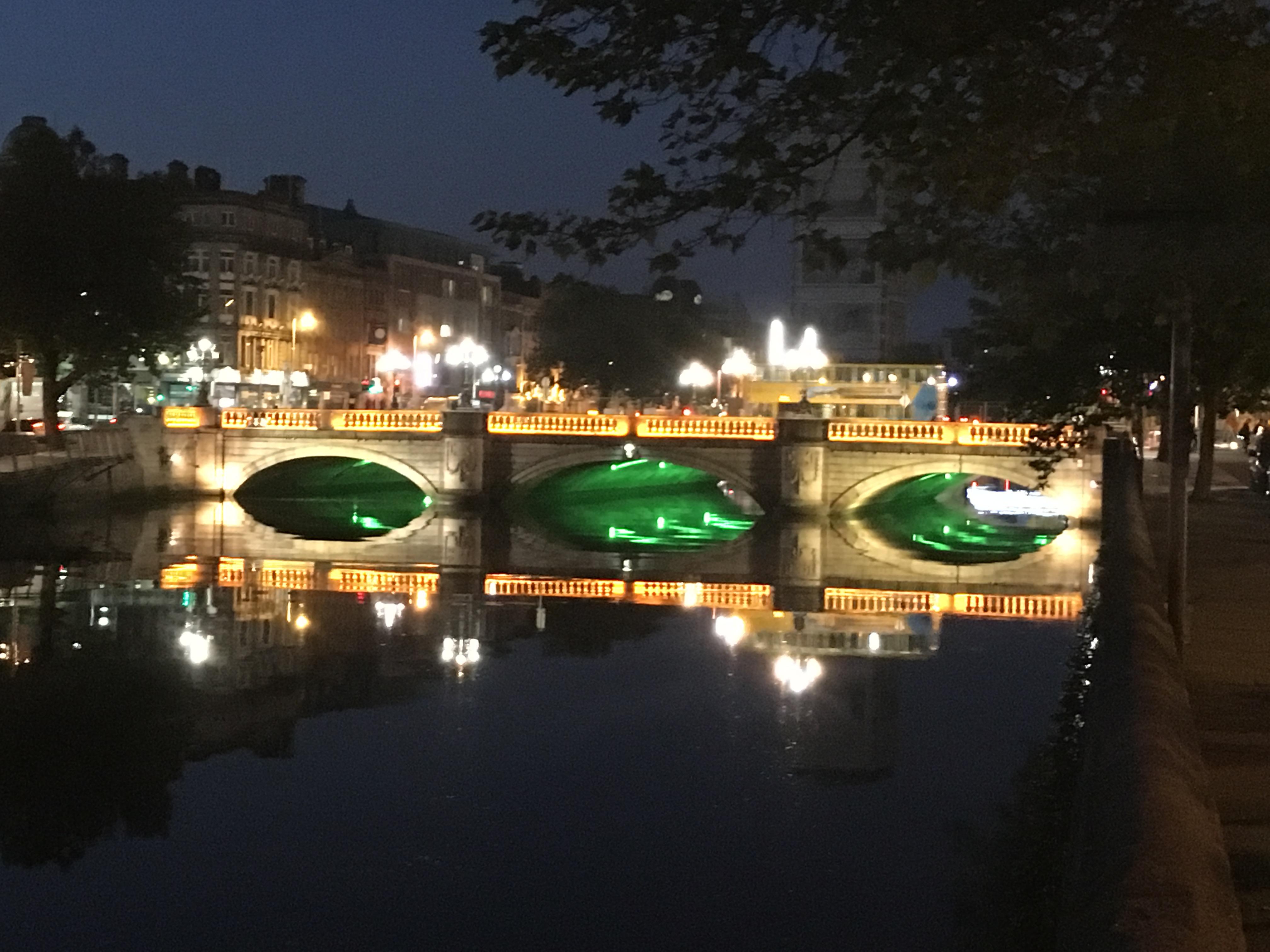 A picture of an illuminated bridge in Dublin.