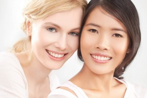 Two women smiling. Give your smile and your spirits a lift with tooth whitening - it's safe and effective when carried out by a professional dentist, hygienist or hygiene therapist. Ask Manor Dental Health in Hull for details.
