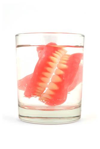 dentures in glass web